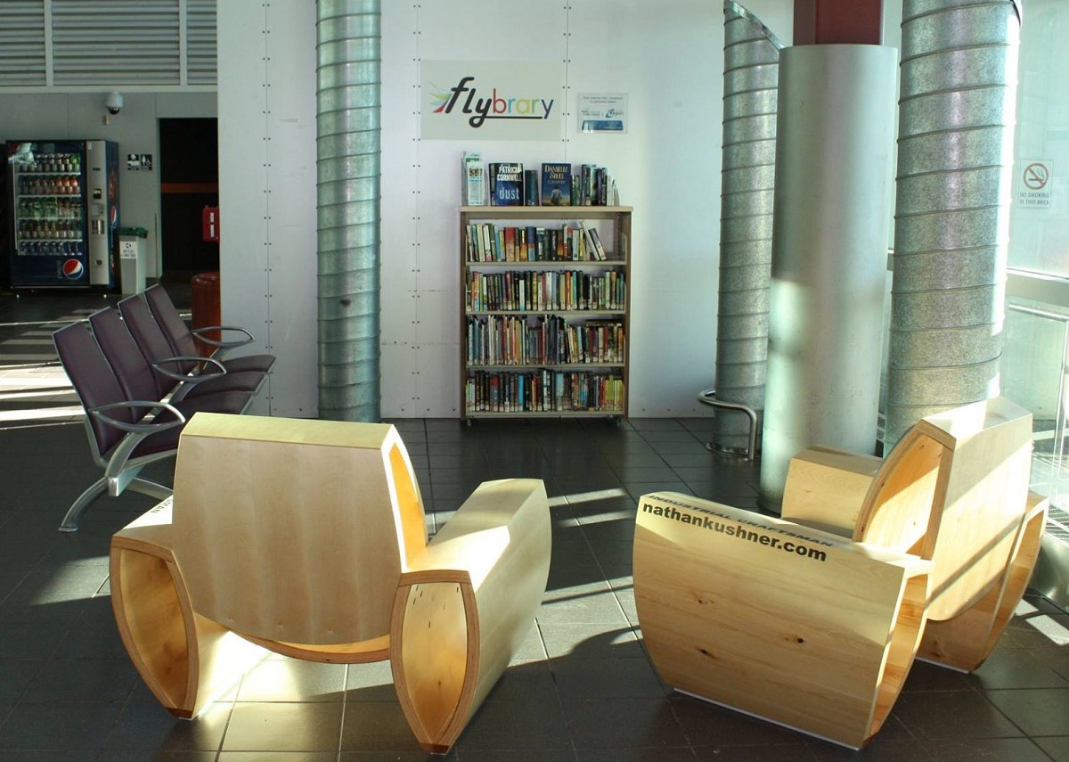 picture of flybrary shelves and chairs located at the airport